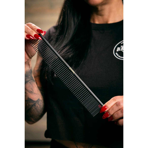 Blackworks X-Large Combo Comb held by pet groomer